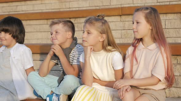 Thumbnail for Attractive Little Children Watching and Listening To Something or Someone Outdoors.