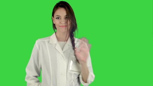 Thumbnail for Smiling Young Woman in Lab Coat Making Funny Dance on a Green Screen, Chroma Key
