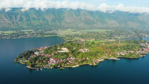 Aerial: flying over lake Toba and Samosir Island Sumatra Indonesia. Huge volcanic caldera