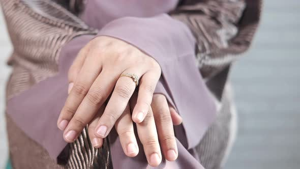 Close Up of Women's Hands with Wedding Ring