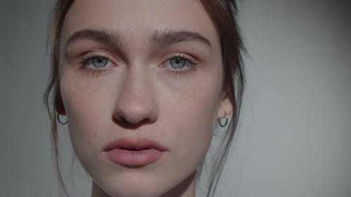Studio Portrait of Beautiful Woman with No Makeup