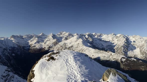 Thumbnail for Panorama on snowcapped mountain peaks and ridges of the majestic italian Alps in winter