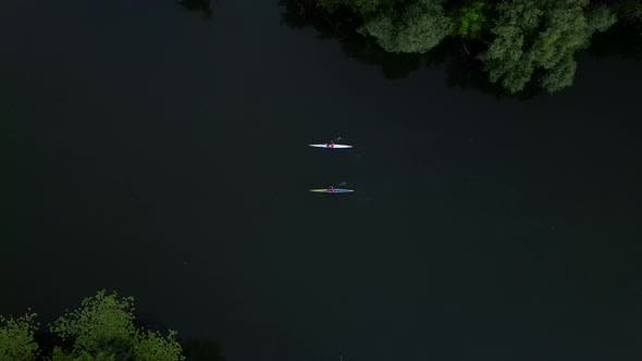 Thumbnail for Aerial Drone Shot of Two Men Riding a Cayaks on Small River, Bird Eye View  Footage
