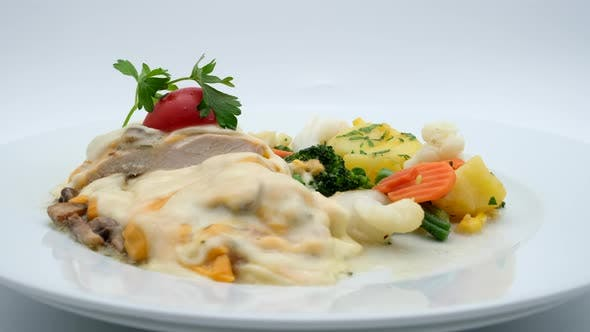 Delicious Restaurant Food Turkey in Cheese With Vegetables
