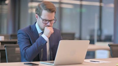 Businessman with Laptop having Coughing