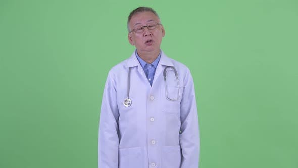 Thumbnail for Stressed Mature Japanese Man Doctor Looking Bored and Tired