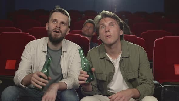 Thumbnail for Men Watching Thriller and Drinking Beer in Cinema