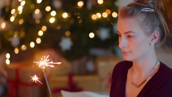 Thumbnail for Woman Igniting Sparkler At Home During Christmas