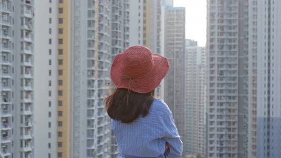 Thumbnail for Woman look at the building and think in city of Hong Kong