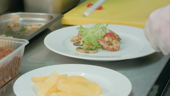 Thumbnail for Chef's Male Hands Making Seafood Appetizer on a White Plate