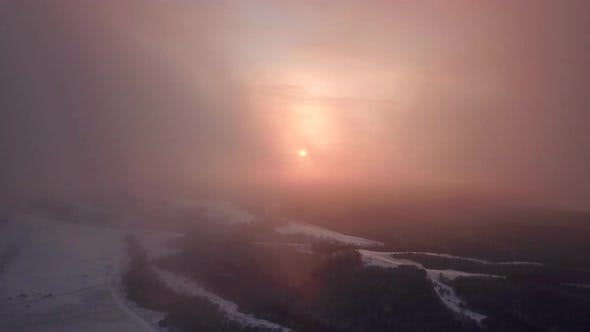 Cover Image for Beautiful Winter Nature Aerial Footage Of Sunset In The Mountains