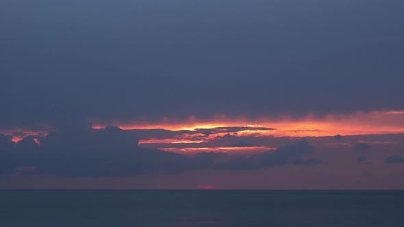 Thumbnail for Evening Sky Sunset with Moving Clouds and Solar Disk Sets Into the Horizon Above the Sea