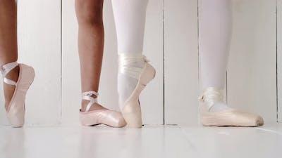 Feet of Teacher Teaching Liitleballerina Student