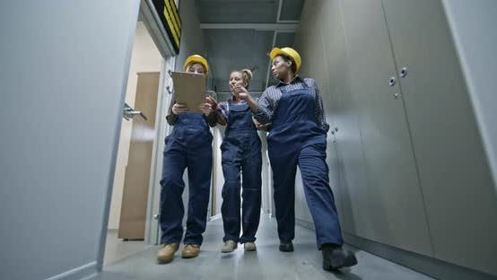 Thumbnail for Female Construction Workers Going through Corridor