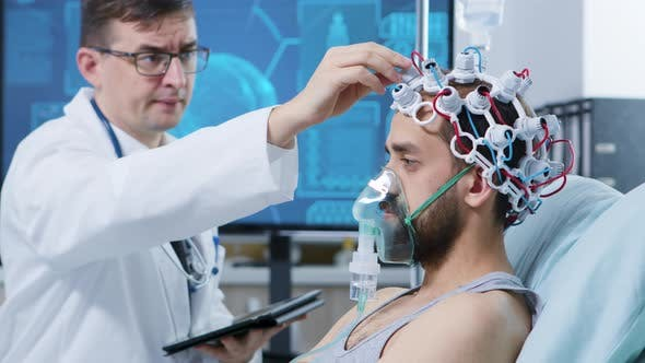 Doctor in a Modern Facility for Brain Research Looking at Tablet