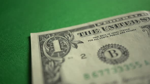 One 1 Dollar Bill On Table Isolated On Chroma Key Green Screen Background