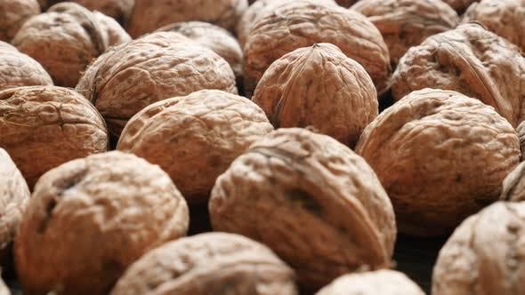 Thumbnail for Essen hintergrund Juglans genus Walnuss Obst Schalen 4K 3840X2160 30fps UHD panning footage - Lot of