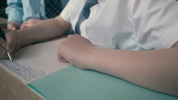 Thumbnail for Schoolchildren Do Homework, Write Numbers in Notebook