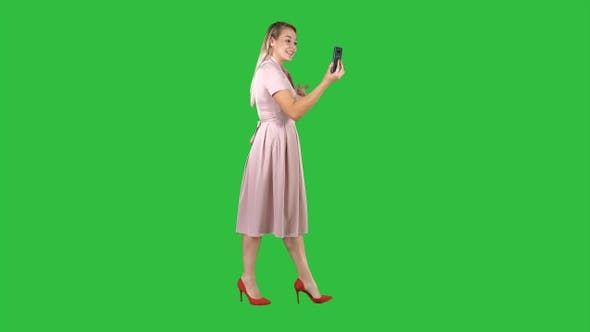 Cover Image for Young Woman in Pink Holding Using Smart Phone Recording