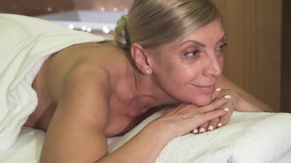 Thumbnail for Beautiful Woman Relaxes Lying on Massage Table