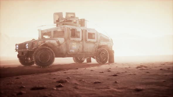 Military Patrol Car on Sunset in Desert Storm
