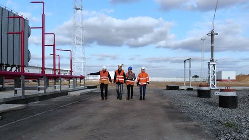 Inspectors Walk To Check Electrical Distribution Substation