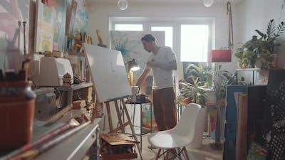 Man Lighting Incense Stick in Art Studio