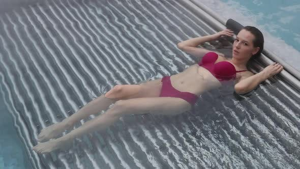 Seductive Female Resting in Pool