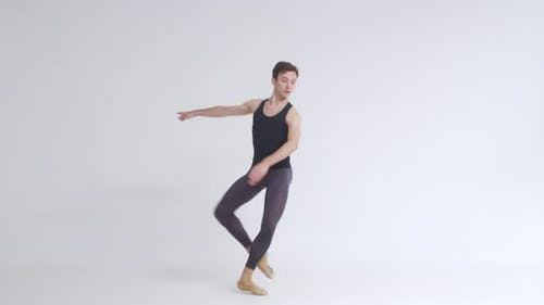 Young Male Ballet Dancer Performs Pirouette and Acrobatic Elements in Ballet Dance White Background