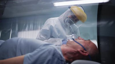 Senior Man in Respirator Talking with Doctor