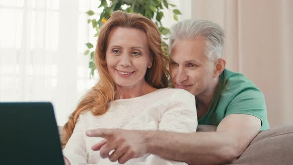 Thumbnail for Aged Spouses Using Computer Together