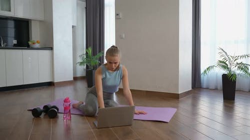 Active Woman Watching Fitness Video Laptop