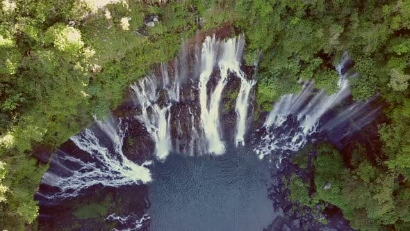Thumbnail for Aerial view of waterfalls and people canyoneering in Reunion island.