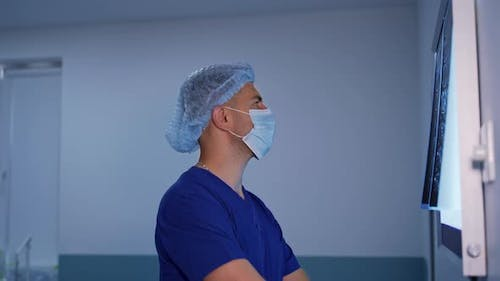 Male medical specialist studying x-ray