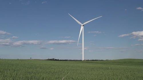 North Dakota Great Plains in Summer with Wheat Field Farm and Wind Turbine and Blue Sky