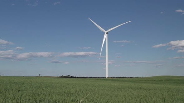 Thumbnail for North Dakota Great Plains in Summer with Wheat Field Farm and Wind Turbine and Blue Sky