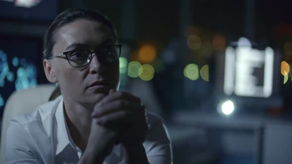 Cover Image for Female IT Programmer Working in Dark Office