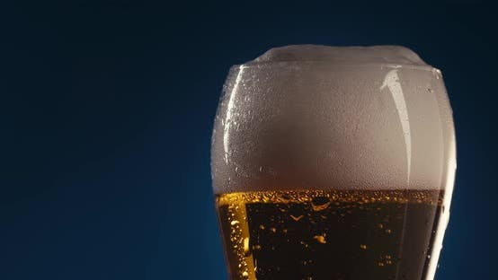 Cover Image for Refilling A Glass With Beer