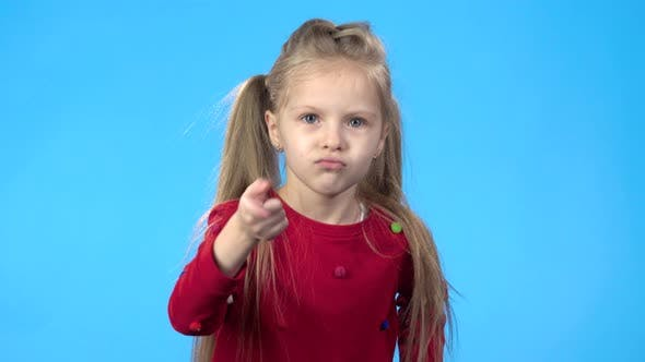 Thumbnail for Little Girl Looking at Camera, Threatening with Finger To Someone.