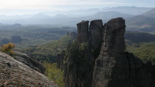 Old group of rocks near town of Belogradchik  slow tilt 4K 2160p 30fps UltraHD footage - Valley with