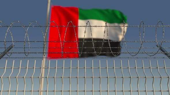 Cover Image for Barbed Wire Against Waving Flag of the UAE