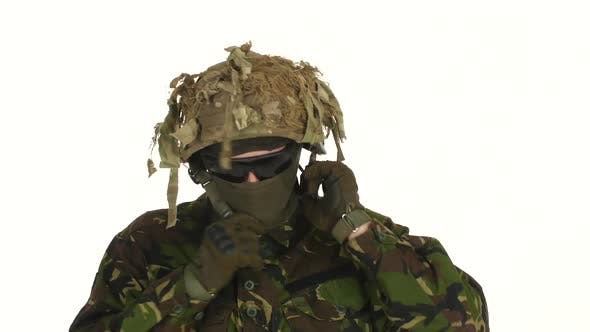 Thumbnail for Soldier Wears a Helmet on His Head, White Backgraund