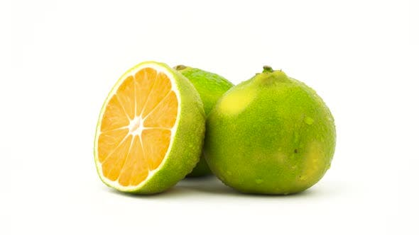 Thumbnail for Two Whole and One Half Cut Green Tangerine Fruits