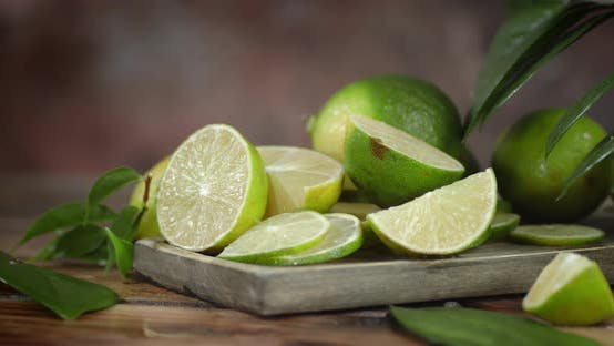 Sliced Juicy Lime with Leaves Rotates Slowly