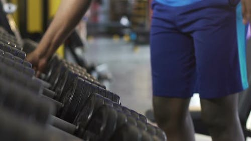 Males Taking Heavy Dumbbells From Stand in Gym, Physical Workout, Weight Lifting