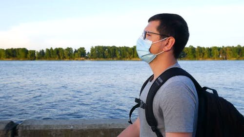 A Man In A Mask Walks Near The River