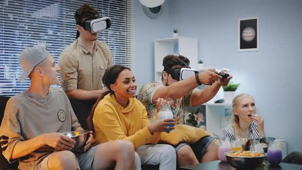 Thumbnail for Two Handsome Boys Playing Console Game in Virtual Reality Glasses Among Cheerful Company