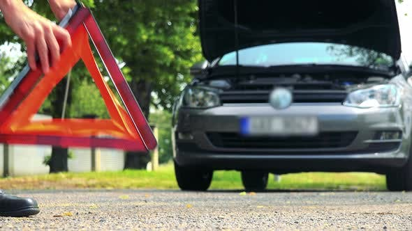 Thumbnail for Senior Man Puts Warning Triangle in Front of the Car and Then Controls Engine of the Car