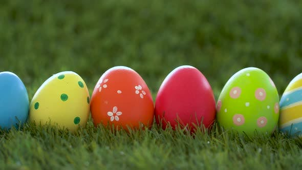 Thumbnail for Row of Colored Easter Eggs on Artificial Grass