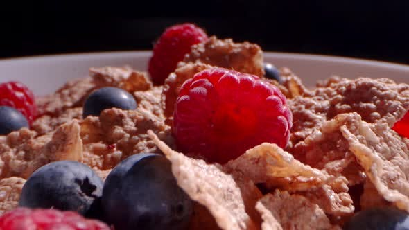 Thumbnail for Macro Details of Cereal with Raspebrries and Blueberries